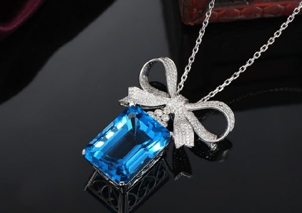60.5ct Natural Blue Topaz in 18K Gold Pendant