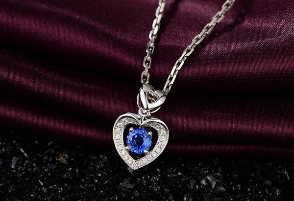 0.6ct Natural Blue Sapphire in 18K Gold Pendant
