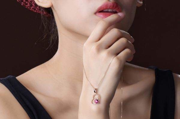 0.65ct Natural Red Tourmaline in 18K Gold Pendant